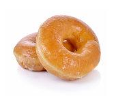 白い背景の上の甘いドーナツ