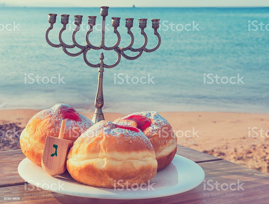 Sweet donuts are traditional Jewish food for Hanukkah holiday stock photo