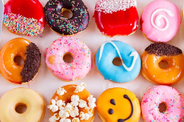 sweet doughnuts on gray stone background stock photo