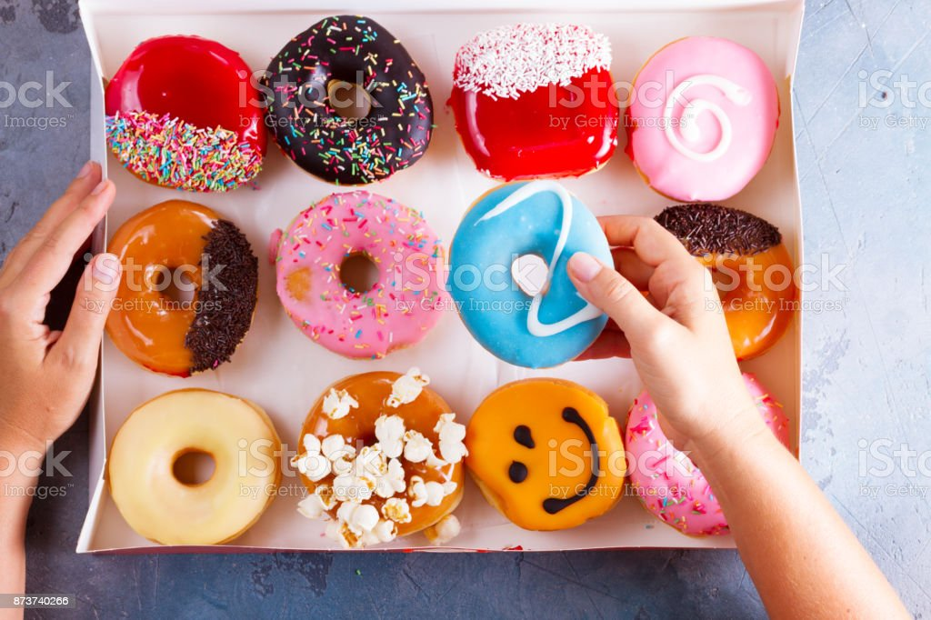 sweet doughnuts on gray stone background stock photo