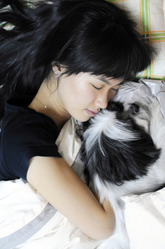 A beautiful female has a sweet dream with her pet