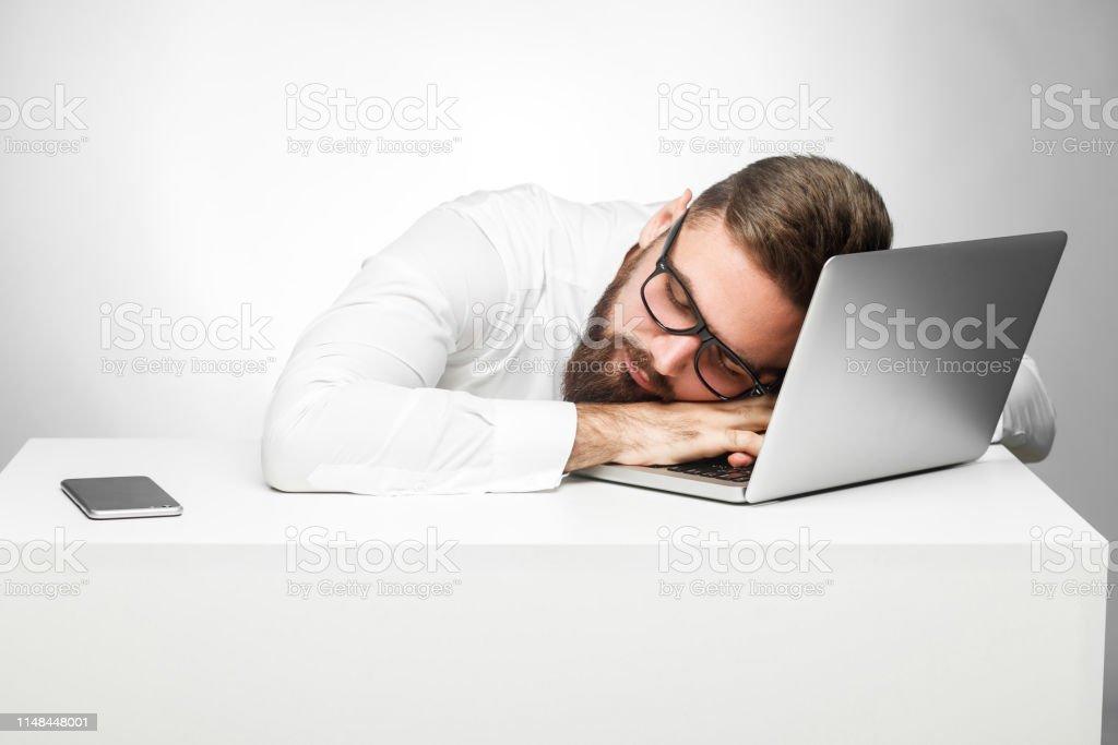 Sweet dreams in the work station. Portrait of sleepy tired freelancer...