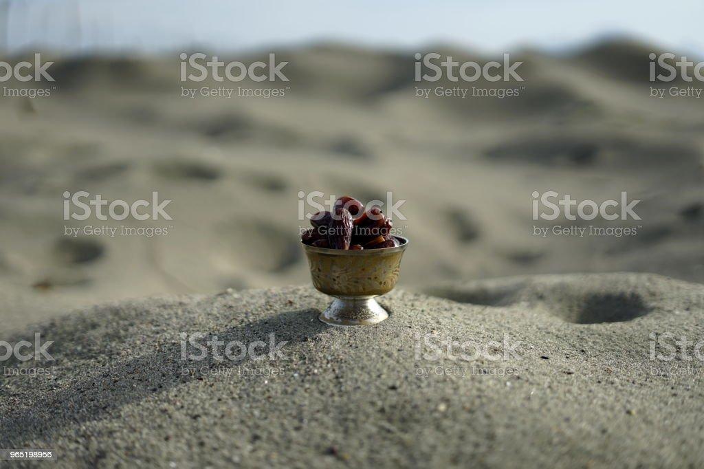 Sweet dried date palm fruits or kurma ramadan (ramazan) food royalty-free stock photo