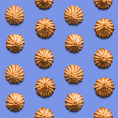 istock Sweet fresh crispy cookies on light violet background. Seamless texture. Top view 1187185065