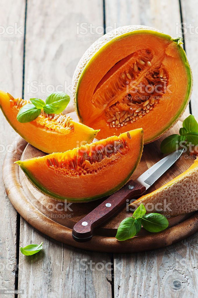 Sweet fresh melon on the wooden table stock photo