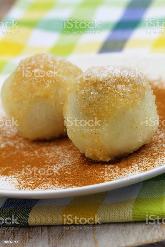 Sweet fruit dumplings sprinked with cinnamon and sugar, closeup stock photo