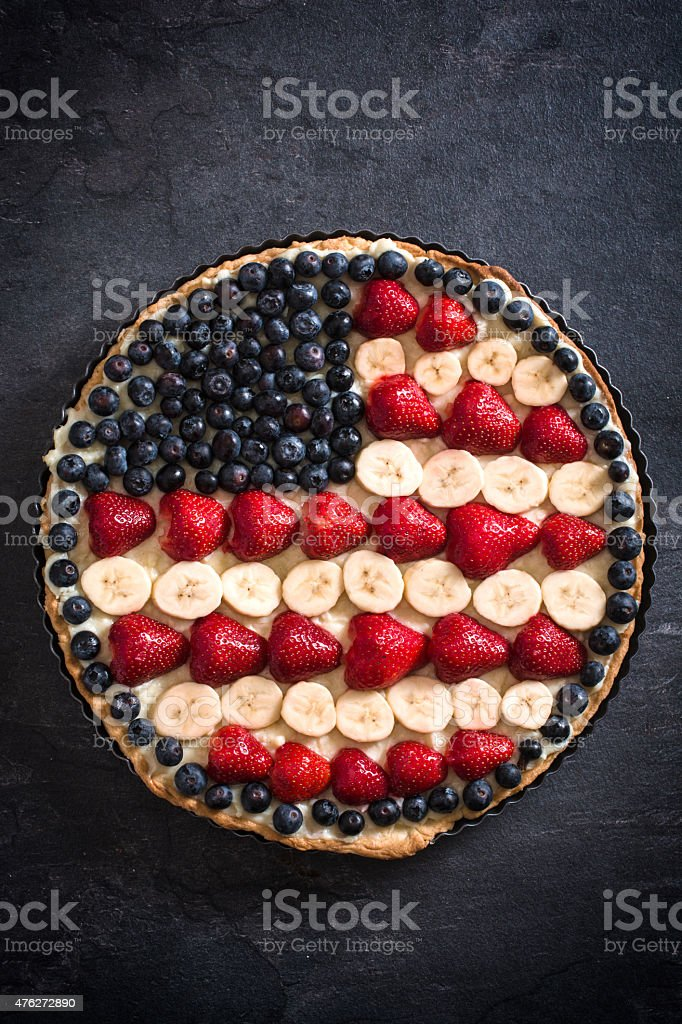 Sweet fruit and vanila pie with USA flag on the top,selective focus...