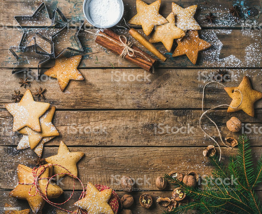 Sweet gingerbread cookies, sugar powder, nuts, spices, molds and fir zbiór zdjęć royalty-free