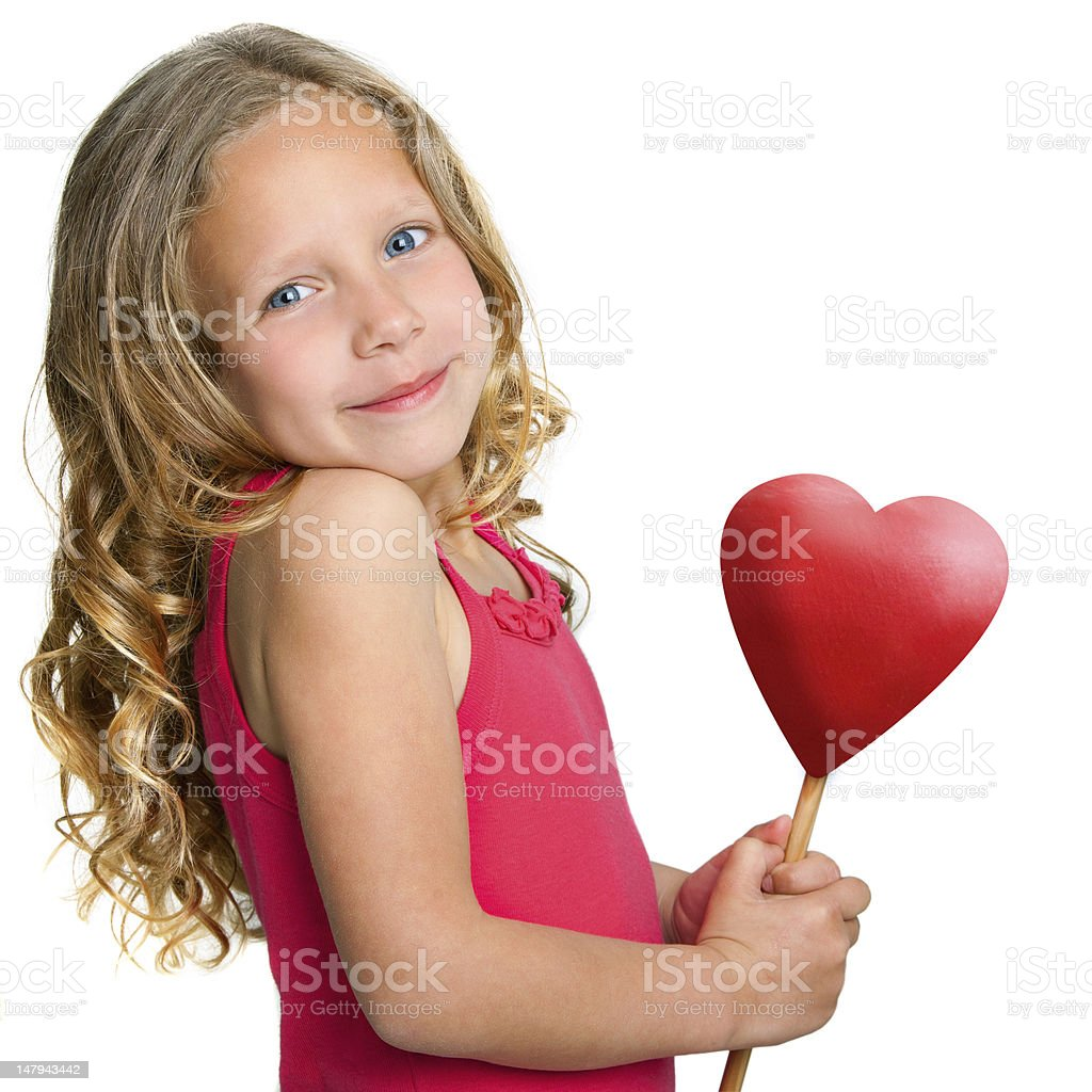 Sweet girl holding red heart. royalty-free stock photo