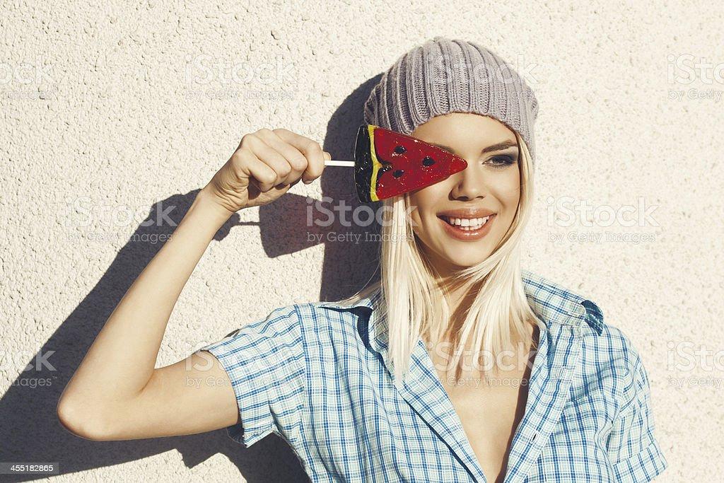 Sweet girl sucking lollipop stock photo