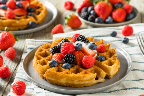 Sweet Homemade Berry Belgian Waffle Sweet Homemade Berry Belgian Waffle with Whipped Cream waffle stock pictures, royalty-free photos & images