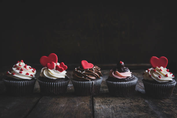 Sweet homemade cupcakes with hearts stock photo