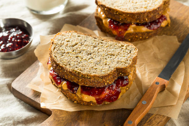 Sweet Homemade Gourmet Peanut Butter and Jelly Sandwich Sweet Homemade Gourmet Peanut Butter and Jelly Sandwich for Lunch jello stock pictures, royalty-free photos & images