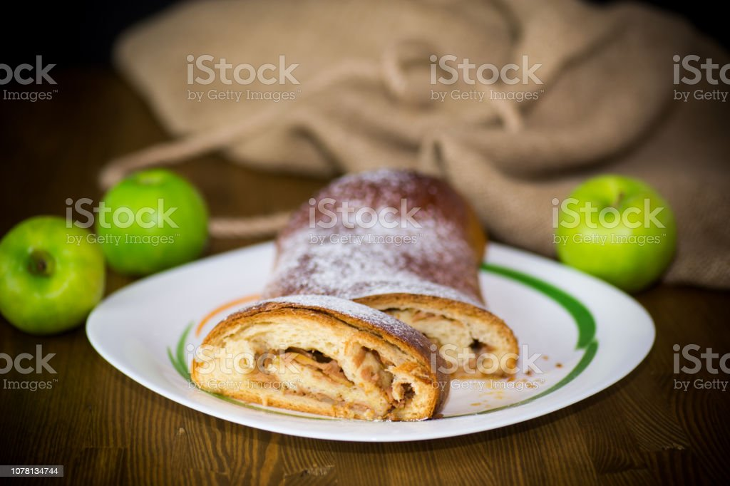 sweet homemade strudel with apples in a plate stock photo