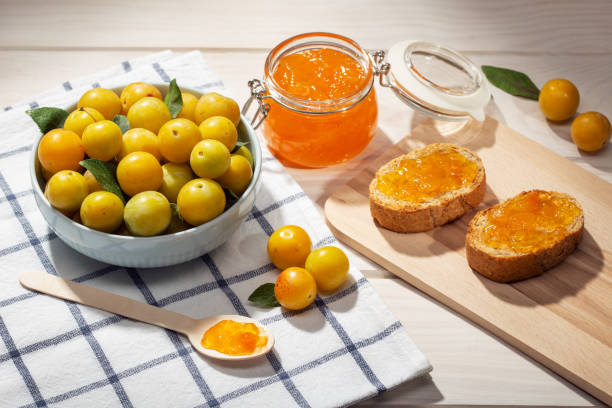 Sweet jam, fruit and toasts stock photo