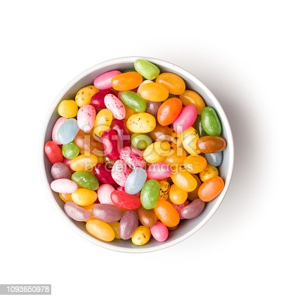 Sweet jelly beans in bowl isolated on white background.