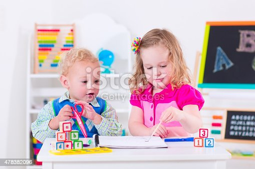 istock Sweet kids at preschool painting 478382096
