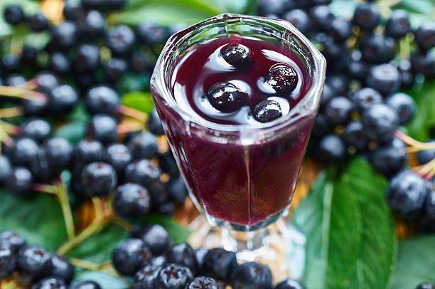Sweet liqueur made from chokeberry and alcohol stock photo