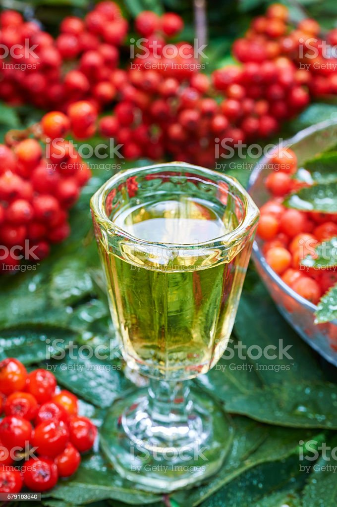 Sweet liqueur made from rowan berry and alcohol stock photo