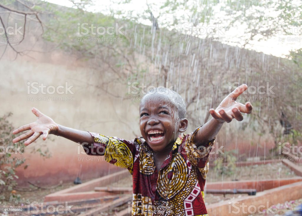 Sweet Little African Boy Under The Rain In Mali Stock Photo Download Image Now Istock