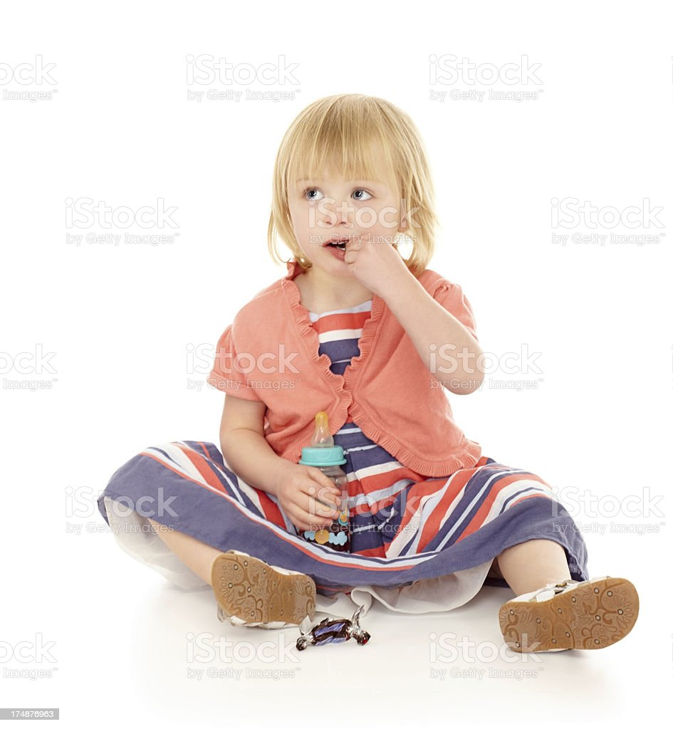 Sweet little baby girl sitting on floor royalty-free stock photo