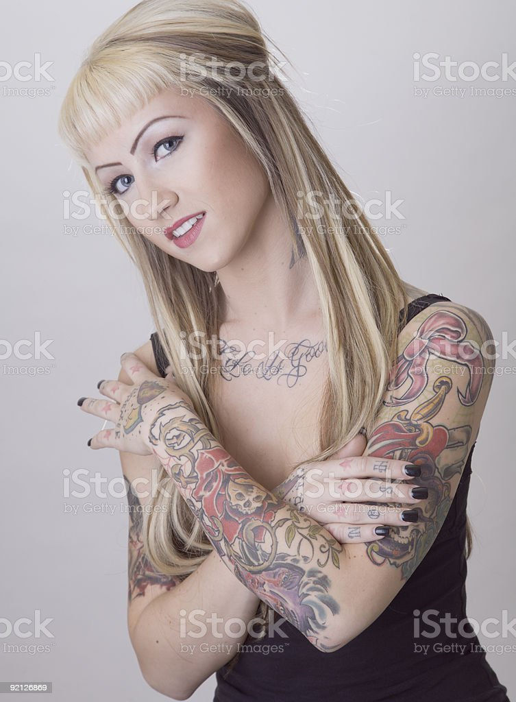 Sweet Little Biker Chick With Tattoos stock photo
