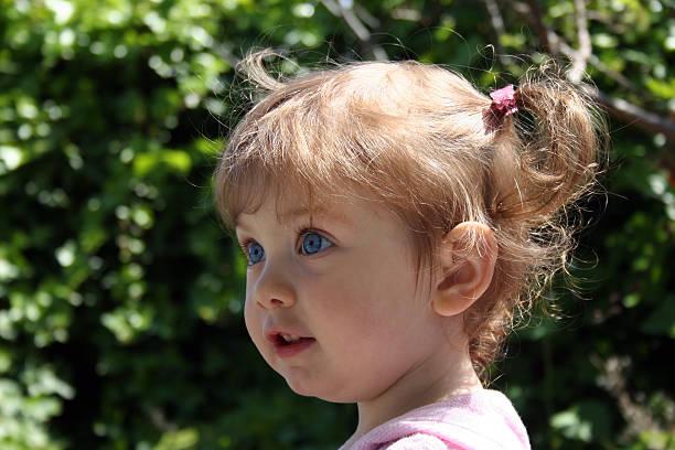 Sweet little blue eyed girl stock photo