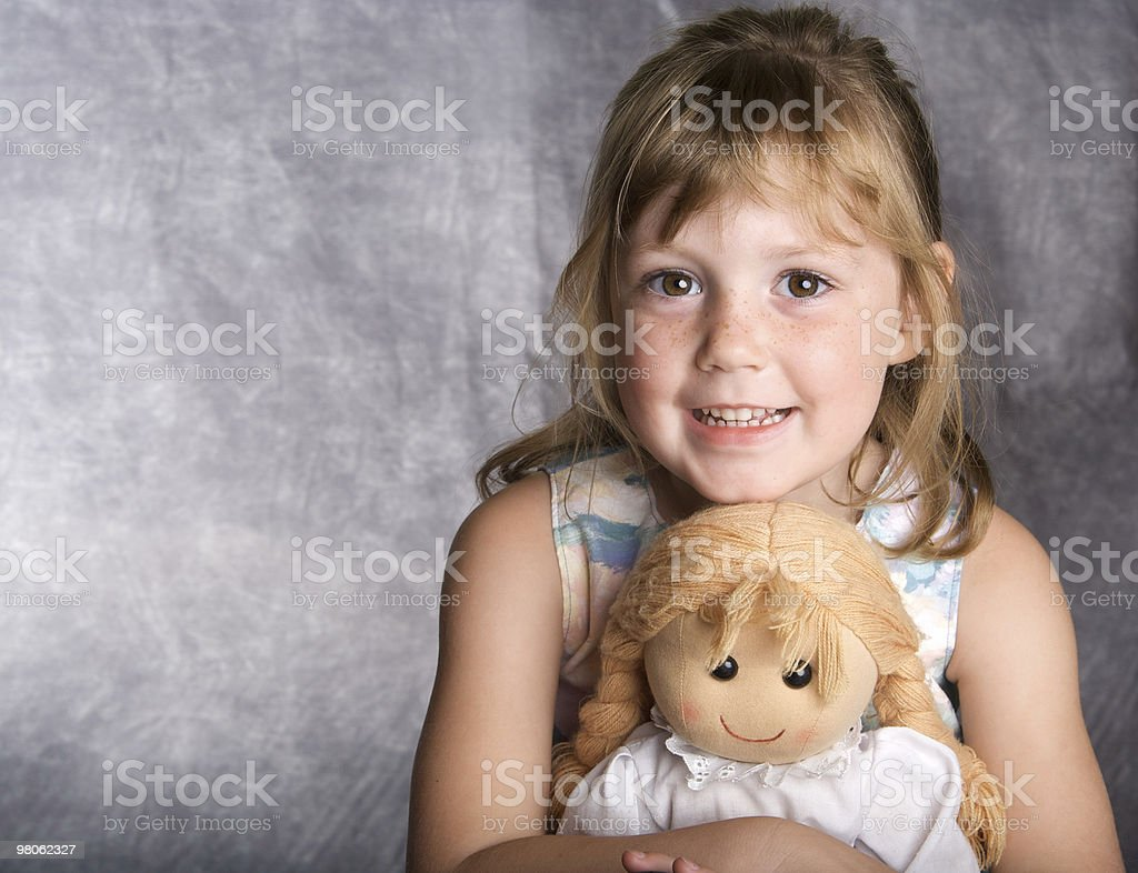 Sweet Little Girl and Her Cloth Doll royalty-free stock photo