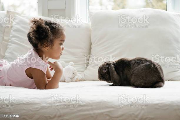 Sweet little girl lying on bed with a cute rabbit ram during easter picture id922146546?b=1&k=6&m=922146546&s=612x612&h=ra6jb9hevjm 4rsxcdadphdof 4ep9pws43vit xgk4=