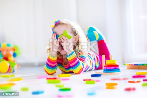 470874196istockphoto Sweet little girl playing with wooden toys 470874222