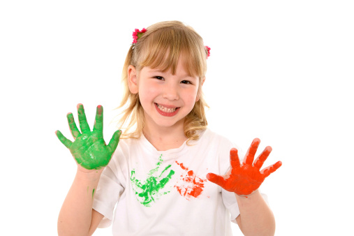Happy Sweet little girl 4 or 5 years old having fun smiling in cute face expression and showing painted hands in vibrant color isolated on white background