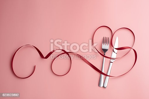 istock Sweet Love White Dish, Knife and Fork Around Red Ribbon 623523892