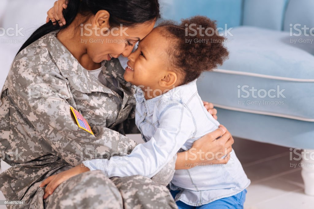 Sweet loving family cuddling in a living room stock photo
