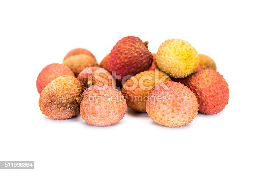 Sweet lychees fruits on wood background .