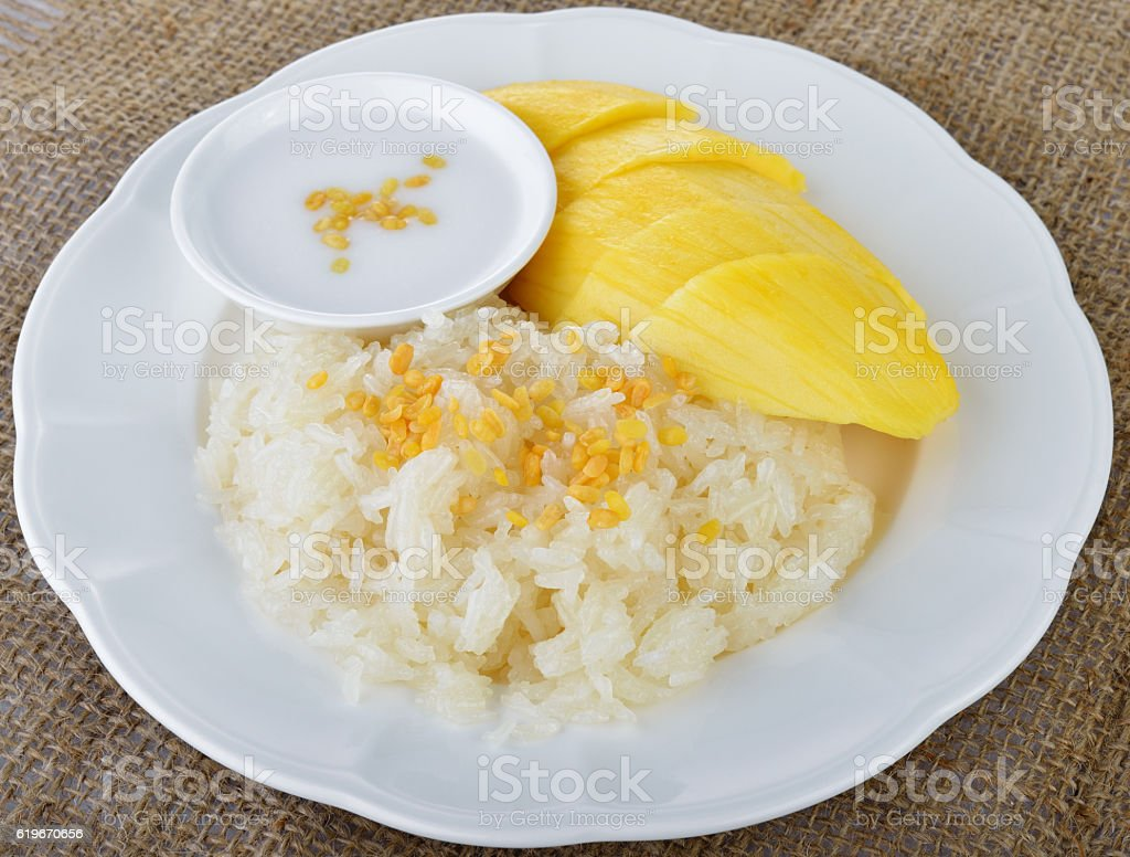 Sweet mango with sticky rice mix with coconut milk stock photo