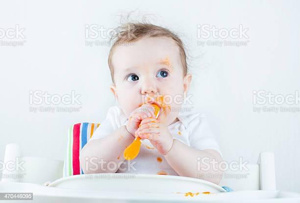 Sweet messy baby eating carrot in white high chair picture id470446095?b=1&k=6&m=470446095&s=612x612&h=godnpg8w248fvvel1cmmb9jinih641 dawpr9jijopi=