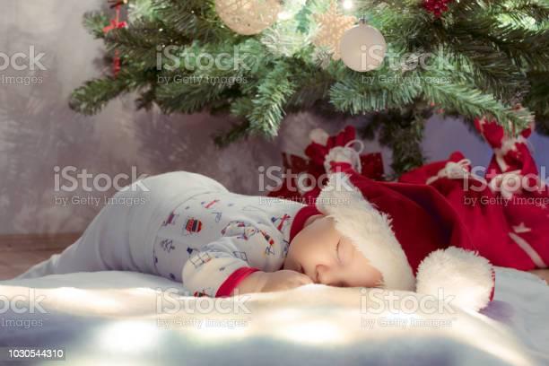 Sweet newborn baby boy sleeping and dreaming under christmas tree picture id1030544310?b=1&k=6&m=1030544310&s=612x612&h=lmlblty0ujeibgjt lwfocrrjyuboldjejy yo mdz4=