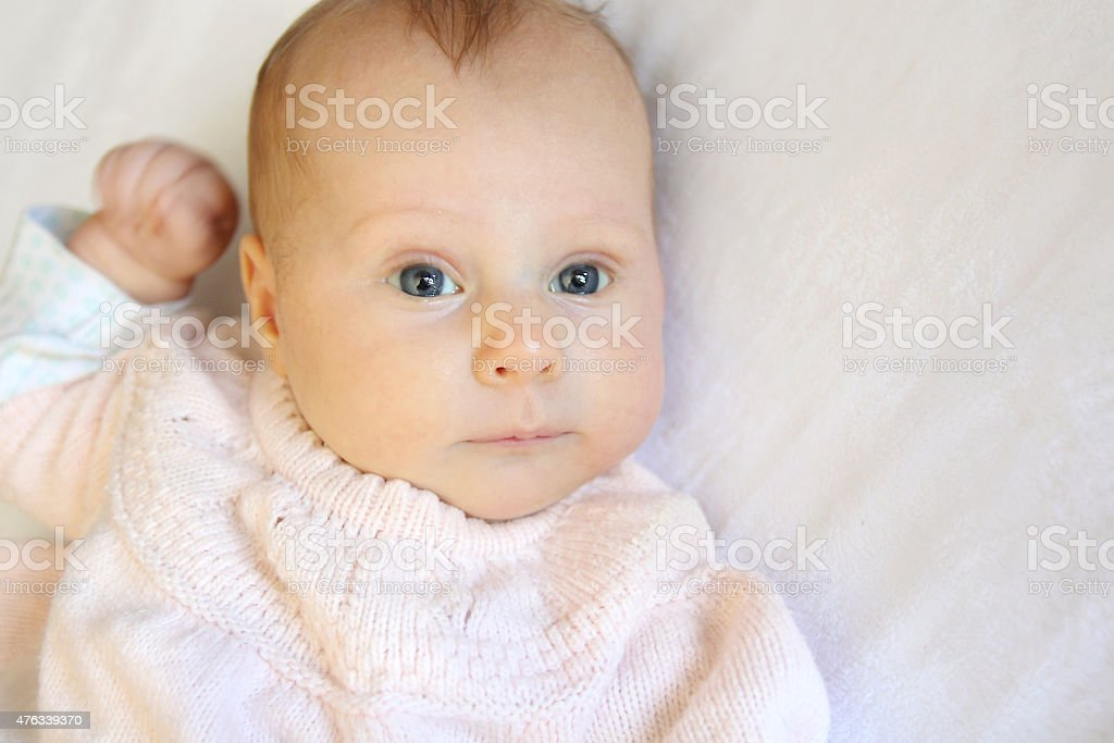 Sweet Newborn Baby Girl With Bright Blue Eyes stock photo