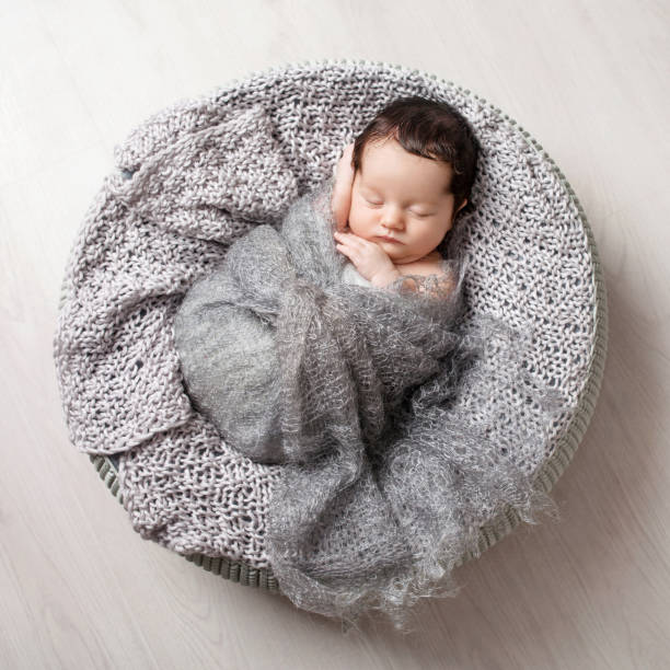 Sweet newborn baby sleeping.  Lovely newborn  2 weeks old lying in the cocon. Copy space Sweet newborn baby sleeping.  Lovely newborn  2 weeks old lying in the cocon. Copy space wrapped in a blanket stock pictures, royalty-free photos & images