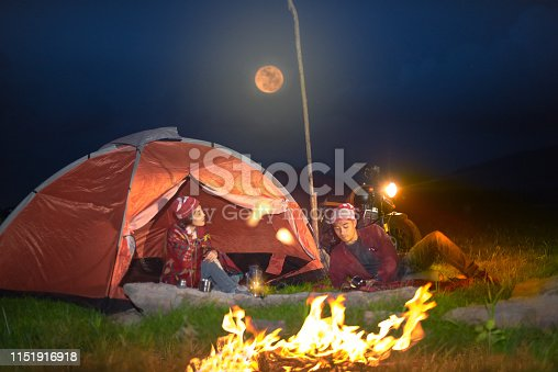 couple lover enjoy camping at the night inside tent, countryside trvelling of the couple lover, campfire enjoying