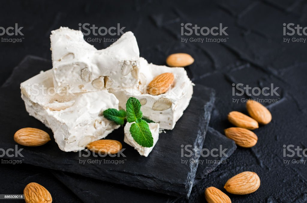 Sweet nougat with almonds stock photo