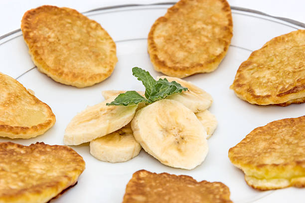 Sweet pancakes on the plate with pieces of banaba stock photo