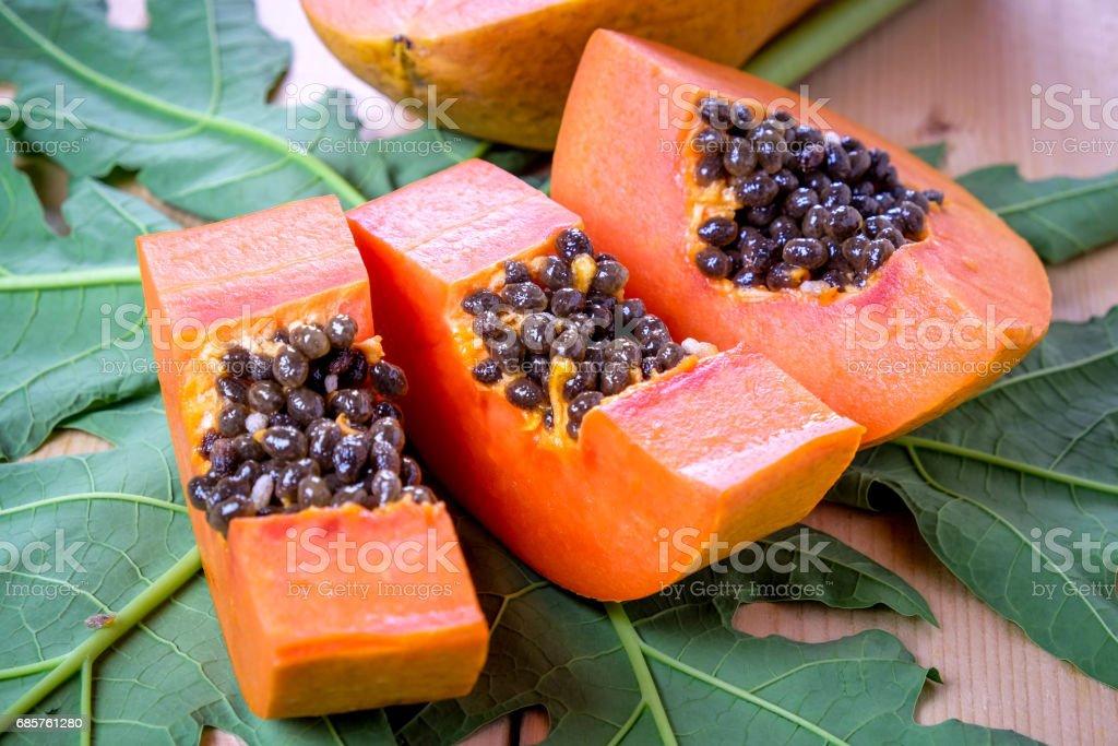 sweet papaya fruit on wooden background. royaltyfri bildbanksbilder