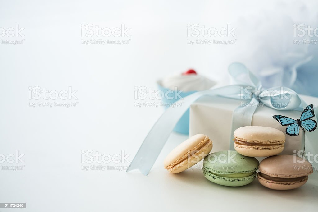 Sweet party table with macaroons and gift stock photo