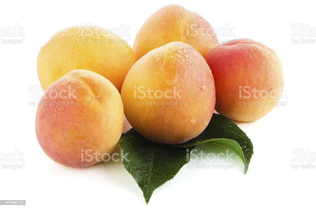 Sweet peaches with leafs royalty-free stock photo