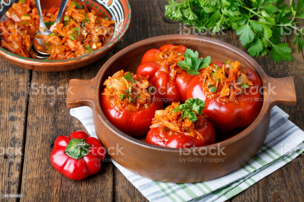Sweet pepper stuffed with vegetables. Tomato shaped pepper ratunda ( gogoshar ). stock photo