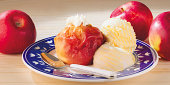 Delicious baked apple with ice-cream.