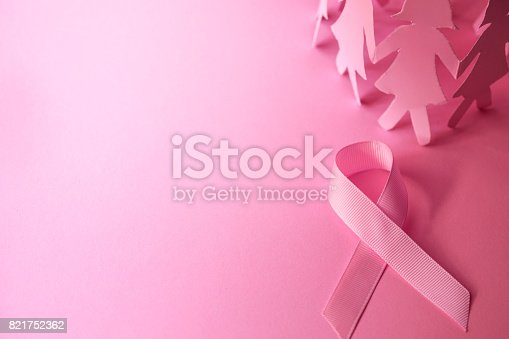 istock Sweet pink ribbon shape with the girl paper doll on pink background  for Breast Cancer Awareness symbol to promote  in october month campaign 821752362