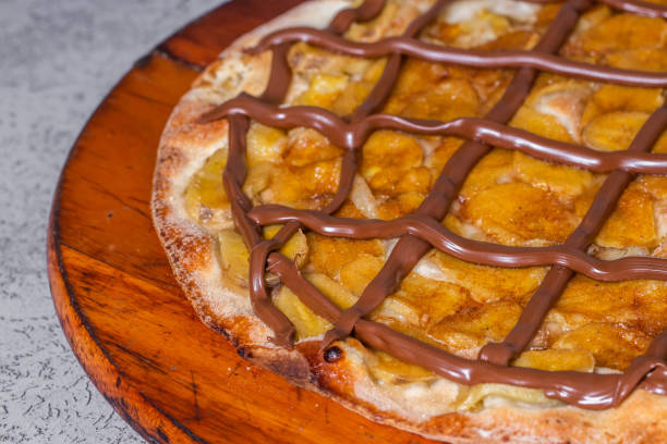 sweet pizza. pizza with banana and chocolate sweet pizza. pizza with banana and chocolate. estudio stock pictures, royalty-free photos & images
