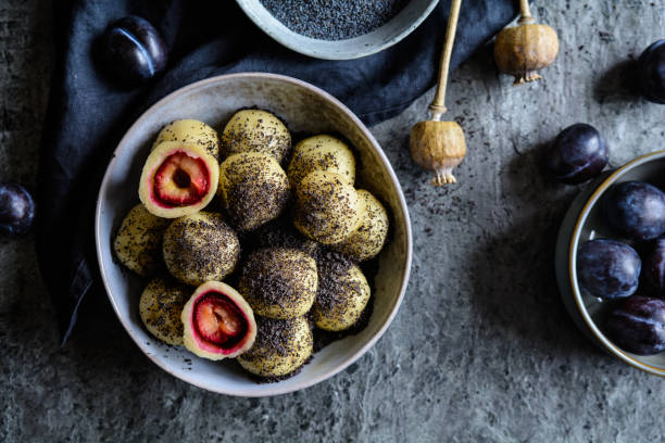 Sweet plum dumplings with poppy seeds Traditional sweet plum dumplings with poppy seeds czech culture stock pictures, royalty-free photos & images
